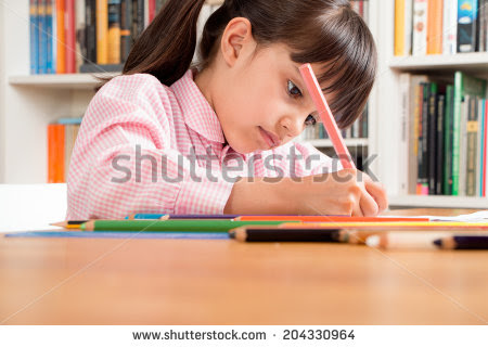 Little Betty engrossed in her homework